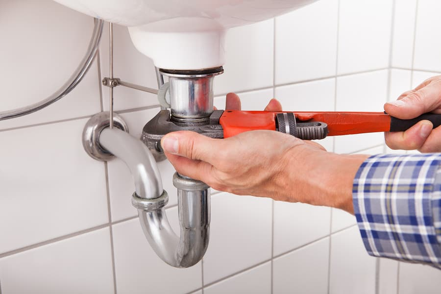 Plumber Fitting Sink Pipe